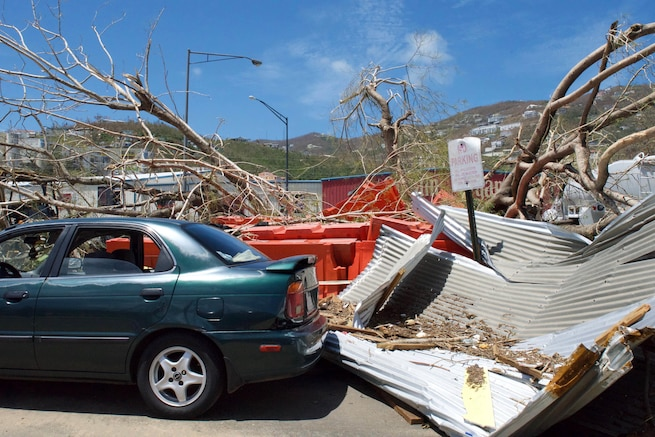 A car sits parked amid debris and felled tree limbs on St. Thomas in the U.S. Virgin Islands, Sept. 9, 2017. Hurricane Irma damaged or destroyed much of the infrastructure on the island. Air Force photo by Capt. Lauren Hill