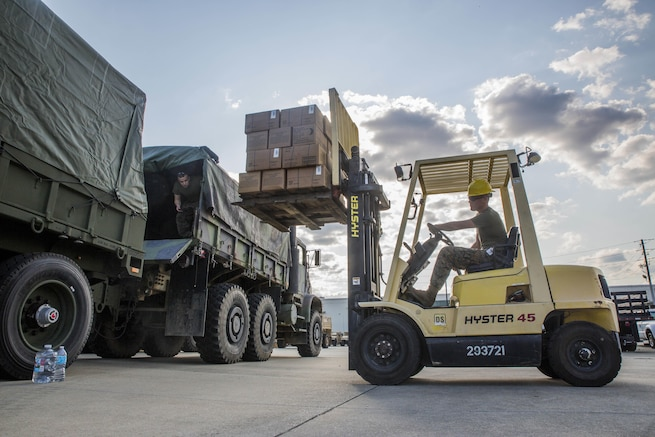 Marines load supplies and equipment on a truck at the Alabama Army National Guard Fort Whiting Armory in Mobile, Ala., Sept. 9, 2017, while preparing for potential rescue missions after Irma's landfall in the U.S. The Marines are reservists assigned to the 3rd Force Reconnaissance Company. Marine Corps photo by Lance Cpl. Niles Lee