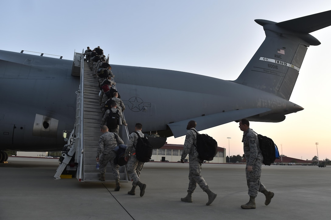 Airmen from the 821st Contingency Response Group board a C-5M Super Galaxy, September 9, 2017, at Travis Airforce Base, Calif.  Two contingency response teams from the 821st Contingency Response Group at Travis Airforce Base, Calif., and a third from the 621st Contingency Response Group at Joint Base McGuire-Dix-Lakehurst, N.J. prepositioned at Scott AFB, to await forward deployment to support ongoing relief efforts in the wake of Hurricane Irma.  (U.S. Air Force photo by Tech. Sgt. Liliana Moreno/Released)