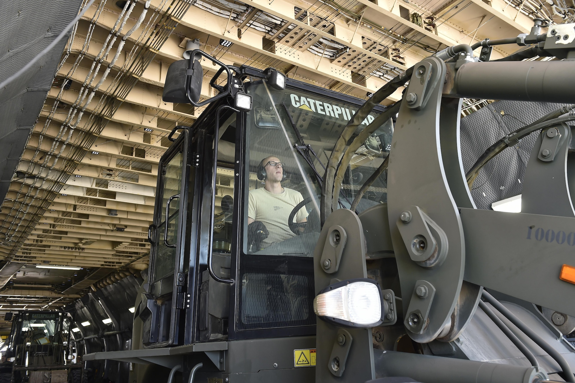 Senior Airman Justin Polk, 821st Contingency Response Support Squadron aerial porter, offloads the 10K All Terrain forklift, September 9, 2017, at Scott Air Force Base, Ill.  Two contingency response teams from the 821st Contingency Response Group at Travis Airforce Base, Calif., and a third from the 621st Contingency Response Group at Joint Base McGuire-Dix-Lakehurst, N.J. prepositioned at Scott AFB, to await forward deployment to support ongoing relief efforts in the wake of Hurricane Irma.  (U.S. Air Force photo by Tech. Sgt. Liliana Moreno/Released)