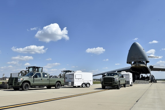 Cargo is offloaded from a C-5M Super Galaxy, September 9, 2017, at Scott Air Force Base, Ill. Two contingency response teams from the 821st Contingency Response Group at Travis Airforce Base, Calif., and a third from the 621st Contingency Response Group at Joint Base McGuire-Dix-Lakehurst, N.J. prepositioned at Scott AFB, to await forward deployment to support ongoing relief efforts in the wake of Hurricane Irma.  (U.S. Air Force photo by Tech. Sgt. Liliana Moreno/Released)