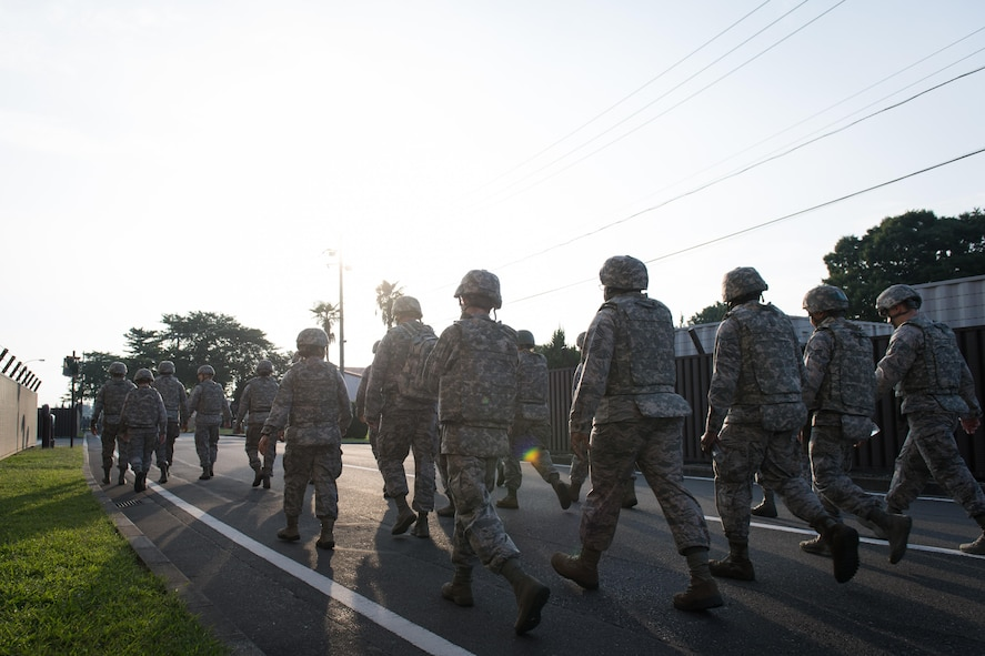 Members of the 374 LRS marched around the base to honor those who have lost their lives due to the terrorist attacks that took place on Sept. 11, 2011. (U.S. Air Force photo/ Airman 1st Class Juan Torres)