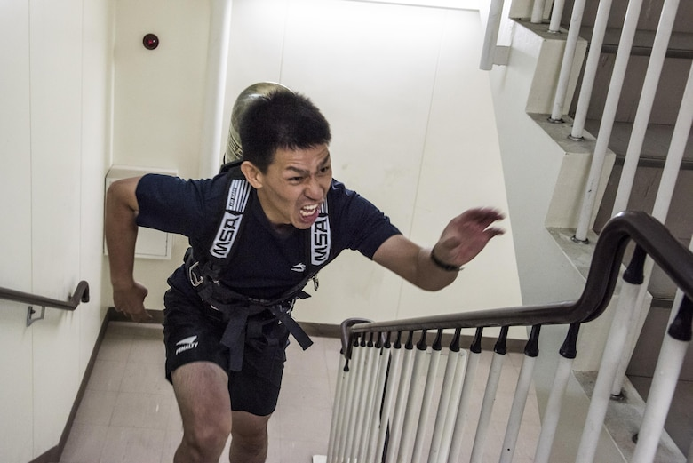 A firefighter from local community runs up a flight of stairs during the Sept. 11 Tower Run at Yokota Air Base, Japan, Sept. 8, 2017.