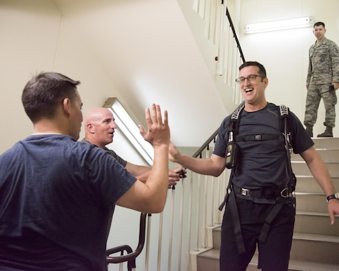 Lt. Col. Jason Jaeger, 374th Airlift Wing director of staff, exchanges a high-five with base leaderships after completing the Sept. 11 Tower Run at Yokota Air Base, Japan, Sept. 8, 2017.