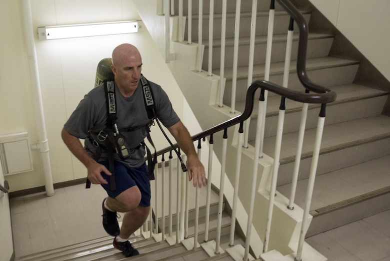 Col. Kenneth Moss, 374th Airlift Wing commander, runs up a flight of stairs during the Sept. 11 Tower Run at Yokota Air Base, Japan, Sept. 8, 2017.