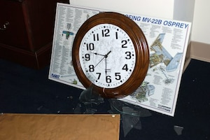 A clock stopped at the time a plane flew into the Pentagon.