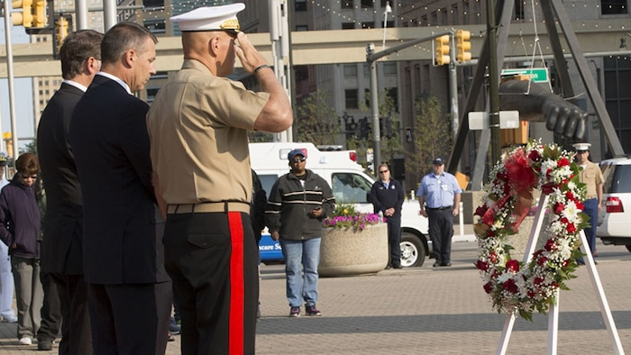 From left, Michigan Sen. Gary Peters, 58, a native of Detroit, John Ellsworth, 45, the father of U.S. Marine Lance Cpl. Justin M. Ellsworth, and Commandant of the Marine Corps Gen. Robert B. Neller honor the wreath of Lance Cpl. Ellsworth at a 9/11 memorial ceremony during Marine Week Detroit, Sept. 10, 2017. Marine Week Detroit is a chance to reconnect with our Marines, sailors, veterans and their families from different generations.