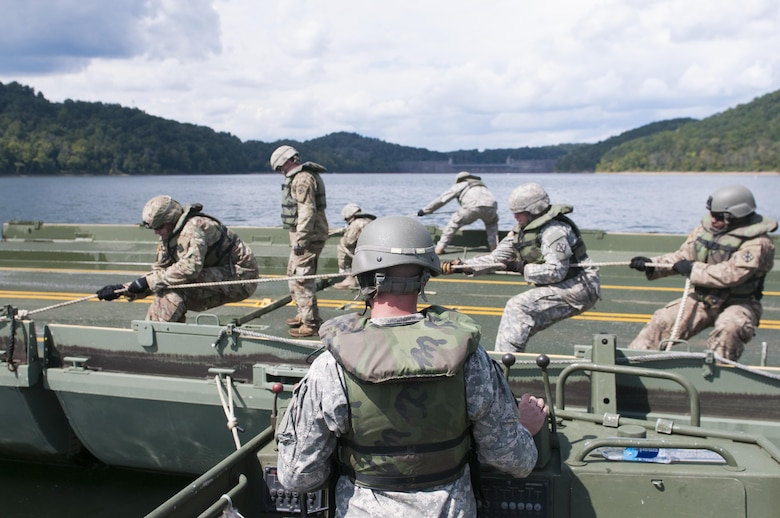 Army reserve Soldiers, with 459th Engineer Company, work to assemble an Improved Ribbon Bridge on the Tygart Lake. The community and local officials were invited to the Tygart Lake State Park Friday, September 8, 2017 to view the unit's bridge building capabilities.