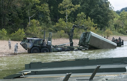 Soldiers from the 459th Engineer Company work to disassemble an Improved Ribbon Bridge during training on the Tygart Lake Friday, September 8, 2017. The training exercise was in support of the Department Of Defense's Immediate Response Authority.