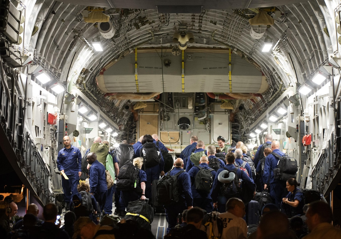 Air Mobility Command C-17s and crews from Joint Base Charleston, S.C., prepare to depart from Washington Dulles International Airport Sept. 9, 2017, to support a tasking from the U.S. Department Health and Human Services to transport approximately 300 healthcare professionals to Orlando International Airport in preparation for Hurricane Irma disaster response operations. This mission will give reach to the hands that heal. (U.S. Air Force photo/Senior Airman Rusty Frank/Released)