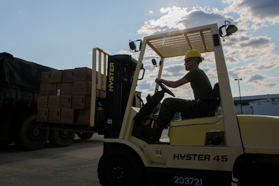 MOBILE, Ala. –U.S. Marine Corps Sgt. Keith Babudar, a motor technician with 3rd Force Reconnaissance Company, 4th Marine Division, Marine Forces Reserve, lifts boxes of Meals Ready to Eat using a forklift at the Alabama National Guard Fort Whiting Armory in Mobile, Ala. on Sept. 9, 2017 in preparation for resupply convoy missions following Hurricane Irma. Marine Forces Reserve is ready to respond to any requests to bolster Northern Command's support of FEMA's assistance to federal, state and local authorities' on going relief efforts in the aftermath of Hurricane Irma. (U.S. Marine Corps Photo by Cpl. Imari J. Dubose/Released)