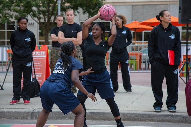 Local children participate in a girls (age 12-19) 3 vs 3 basketball tournament in downtown Detroit as part of Marine Week Detroit, Sept. 9, 2017. Marine Week Detroit is a chance to reconnect with our Marines, Sailors veterans and their families from different generations.