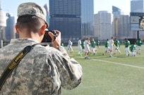 Spc. Miguel Alvarez, assigned to 354th MPAD, Coraopolis, Pennsylvania, photographs the Point Park University's men's soccer team during a training exercise September 5, 2017. The 354 MPAD used the Point Park University's military appreciation game as an opportunity to conduct soldier training for photography and videography.