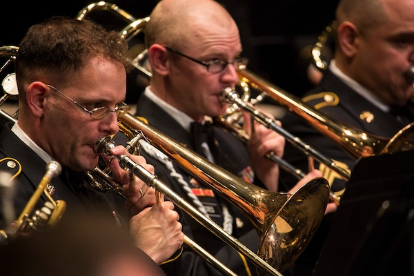 Sgt. Jonathan Solby (left) and Sgt. Daniel Estes (right), trombonists with the 323d Army Band at Joint Base San Antonio-Fort Sam Houston, perform at the Watson Fine Arts Center as part of the San Antonio Youth Wind Ensemble Performance April 13. The 323rd Army Band's final reunion concert – scheduled for Sept. 24 at the Alamo – signifies the impending dissolution of the unit by fall of 2018.
