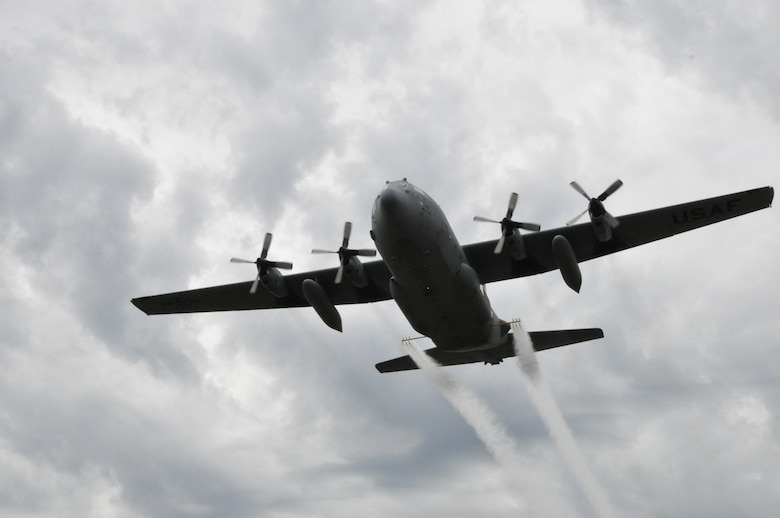 A modified U.S. C-130 aircraft, assigned to the 910th Airlift Wing, sprays water simulating a pesticide solution during a field exercise as part of the Department of Defense Aerial Spray Certification Course, Jan. 13, 2016. The 910th Airlift Wing has been tasked with providing its unique aerial spray capability to assist with recovery efforts in eastern Texas, following the devastation of Hurricane Harvey. Youngstown Air Reserve Station's 910th Airlift Wing is home to DoD's only aerial spray mission.