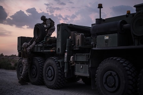 U.S. Marines with Bridge Company, 7th Engineer Support Battalion, 1st Marine Logistics Group, prepare to secure extra concertina wire on a Logistics Vehicle System Replacement truck during Exercise Deep Strike II at Blythe, Calif., September 6, 2017. Logistics Vehicle System Replacement trucks are one of various different vehicles used to transport large amounts of supplies or other vehicles that attribute to the logistical capabilities of the MLG. (U.S. Marine Corps photo by Lance Cpl. Timothy Shoemaker)