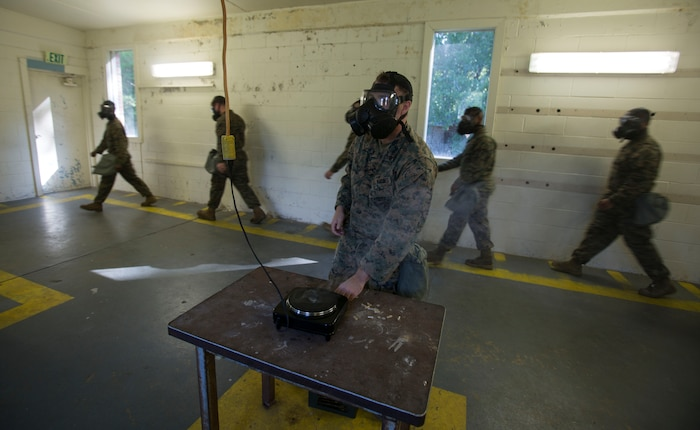 Marines and Sailors with 2nd Medical Battalion air out their uniforms during a quarterly gas chamber qualification on Camp Lejeune, N.C., Sept. 8, 2017.