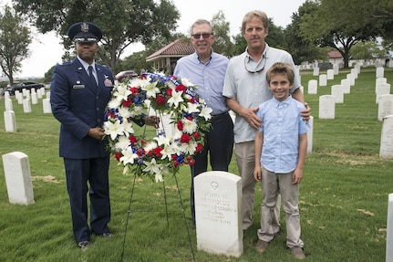 Lt. Col. Christopher Robinson, 91st Cyberspace Operations Squadron Commander, lays flowers on the grave of founding squadron commander Col. John Reynolds alongside members of Reynolds' family Aug. 24 at Joint Base San Antonio-Fort Sam Houston, Texas. The 91st COS began on Aug. 20, 1917 as the 91st Aero Squadron under Col Reynolds' command, a full 100 years ago. (US Air Force photo/Olivia Mendoza)
