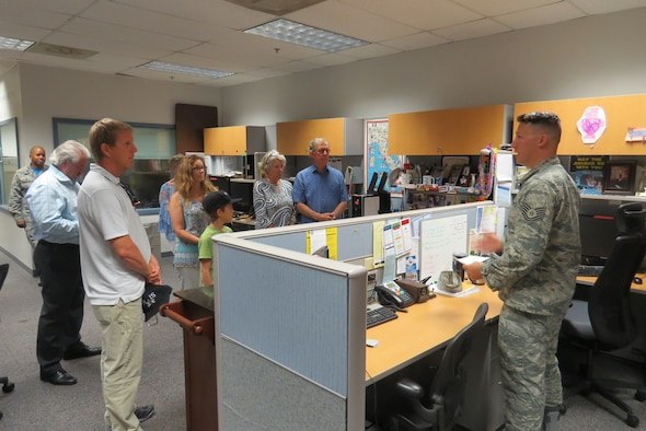 Technical Sgt. Blake Butzer shows a group of family members through the 91st Cyberspace Operations Squadron spaces during an Open House Aug. 25 at Joint Base San Antonio-Lackland, Texas, in support of the 91st COS Centennial. During this event family and friends were treated to snacks, a mission briefing, and a tour of the unit. (Courtesy photo)