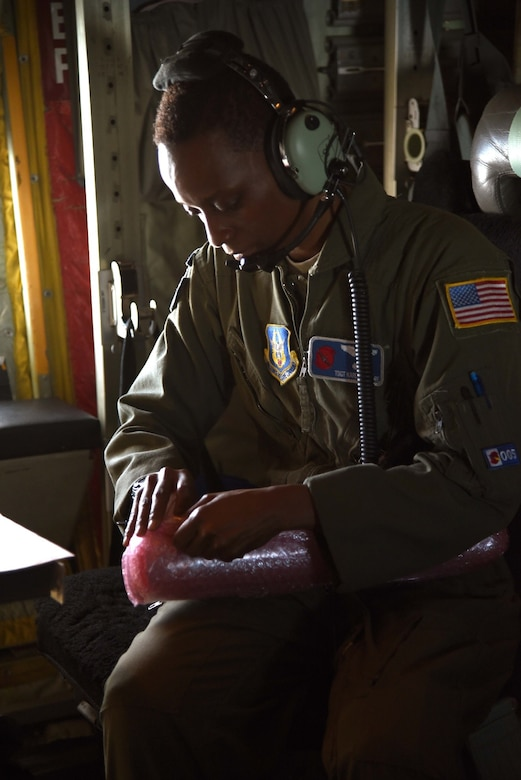 Tech. Sgt. Karen Moore, a loadmaster for the 53rd Weather Reconnaissance Squadron, prepares a dropsonde to be released into the eyewall of Hurricane Irma. Crews have recently been flying missions continuously in three different hurricanes in the Atlantic region simultaneously. (U.S. Air Force photo by: Staff Sgt. Nicholas Monteleone)