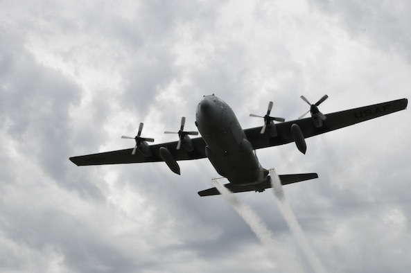 A modified U.S. C-130 aircraft, assigned to the 910th Airlift Wing, sprays water simulating a pesticide solution during a field exercise as part of the Department of Defense Aerial Spray Certification Course, Jan. 13, 2016. The 910th Airlift Wing has been tasked with providing its unique aerial spray capability to assist with recovery efforts in eastern Texas, following the devastation of Hurricane Harvey. Youngstown Air Reserve Station's 910th Airlift Wing is home to DoD's only aerial spray mission. (U.S. Air Force photo/Master Sgt. Bob Barko Jr.)