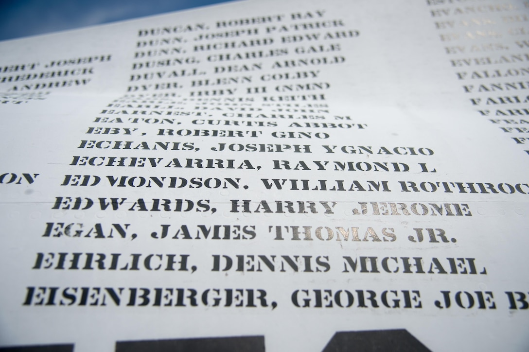 Names line the fuselage of an Army OV-1 Mohawk observation and surveillance aircraft Aug. 27, 2017, during the Thunder Over Dover Open House at Dover Air Force Base, Del. There are 1,636 names on the plane for each service member who never returned home from the Vietnam War. (U.S. Air Force photo by Staff Sgt. Jared Duhon)
