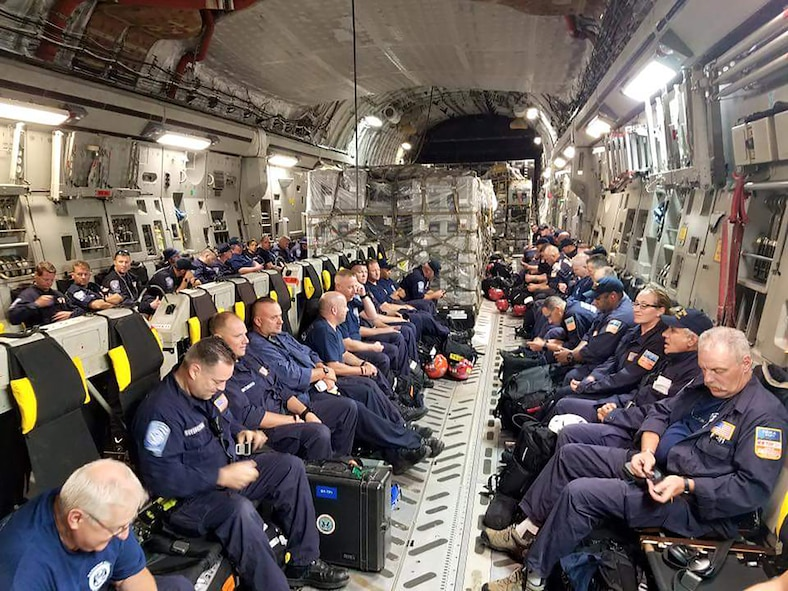 Members of the New York Task Force-1 prepare to board a 445th Airlift C-17 Globemaster III at Robins Air Force Base, Georgia September 8 and were bound for San Juan, Puerto Rico. The group, composed of FDNY and NYPD members trained to respond to catastrophic events, will assist those affected by Hurricane Irma. (Photo credit: NYC Emergency Management)