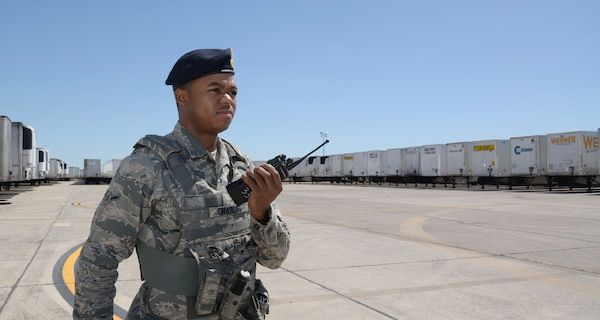 Amn Malcolm Charles, 902nd Security Forces Squadron entry controller, sends a situation report of the Incident Support Base where Federal Emergency Management Agency disaster relief trucks are parked at Joint Base San Antonio-Randolph, Texas, September 7, 2017.