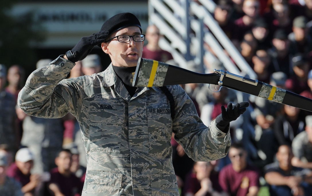 "Airman 1st Class Martin Moran, 334th Training Squadron freestyle drill team drillmaster, spins a rifle during the 81st Training Group drill down on the Levitow Training Support Facility drill pad Sept. 8, 2017, on Keesler Air Force Base, Mississippi. Airmen from the 81st TRG competed in a quarterly open ranks inspection, regulation drill routine and freestyle drill routine. The 334th TRS ""Gators"" took first place this quarter. (U.S. Air Force photo by Kemberly Groue)"