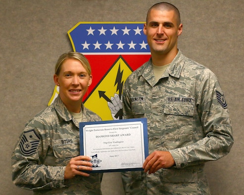 Master Sgt. Ashley Byers, 14th Intelligence Squadron first sergeant, presents the June 2017 Diamond Sharp Award to Tech. Sgt. Eric Wadlington, 87th Aerial Port Squadron, August 5, 2017. The award is for exemplary performance, adherence to the Air Force Core Values, attitude, appearance and ability. (U.S. Air Force photo/Master Sgt. Patrick O'Reilly)