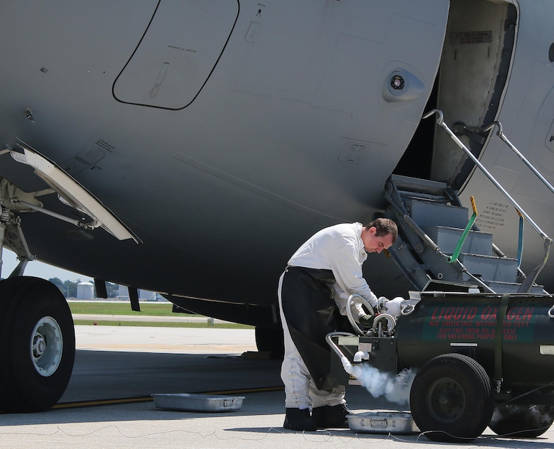 Staff Sgt. Rodney McElfresh, 445th Aircraft Maintenance Squadron crew chief, services liquid oxygen into a C-17 Globemaster III here August 9, 2017. Liquid oxygen is converted to gas in the aircraft which is then used for aircrew in case of emergency as well as for Aeromedical Evacuation patients when in transport. (U.S. Air Force photo/Master Sgt. Patrick O'Reilly)