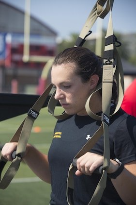 1st Lt. Margo Smutnick, manpower officer, Marine Corps Air Ground Task Force adjutant, readies herself before starting the first tactical movement of the High Intensity Tactical Training Tactical Athlete Championship at the 11 Area Football Field aboard Marine Corps Base Camp Pendleton, Calif., August 30, 2017. The fast paced competition challenged participants mentally and physically to become fit and adaptable Marines capable of fighting in any clime and place. (U.S. Marine Corps photo by Pfc. Margaret Gale)
