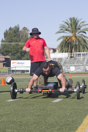 Lance Cpl. Mason McGuff, administrative specialist, air control training squadron, Marine Corps Communication Electronics School, performs a 25-yard movement on the Frog Fitness Frog Total Body Resistance Trainer during a High Intensity Tactical Training Tactical Athlete Championship at the 11 Area Football Field aboard Marine Corps Base Camp Pendleton, Calif., August 30, 2017. The fast paced competition challenged participants mentally and physically to become fit and adaptable Marines capable of fighting in any clime and place. (U.S. Marine Corps photo by Pfc. Margaret Gale)