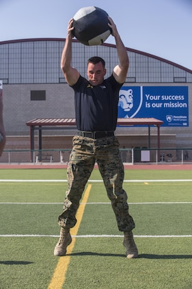 Lance Cpl. Mason McGuff, administrative specialist, air control training squadron, Marine Corps Communication Electronics School, performs 10 medicine ball slams during a High Intensity Tactical Training Tactical Athlete Championship at the 11 Area Football Field aboard Marine Corps Base Camp Pendleton, Calif., August 30, 2017. The fast paced competition challenged participants mentally and physically to become fit and adaptable Marines capable of fighting in any clime and place.