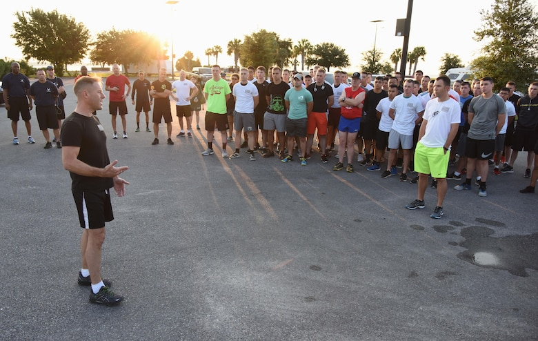 Capt. Gary Baxter, Keesler Marine Corps Detachment commanding officer, speaks to members of the Keesler Air Force Base Marine Detachment prior to a 3.7 mile remembrance run across the Ocean Springs/Biloxi Bridge Sept. 9, 2017, in Mississippi. The event honored those who lost their lives during the 9/11 attacks. (U.S. Air Force photo by Kemberly Groue)