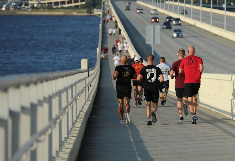 Members of the Keesler Air Force Base Marine Detachment participate in a 3.7 mile remembrance run across the Ocean Springs/Biloxi Bridge Sept. 9, 2017, in Mississippi. The event honored those who lost their lives during the 9/11 attacks. (U.S. Air Force photo by Kemberly Groue)