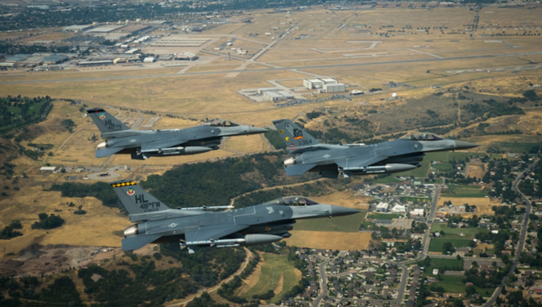 An F-16 painted with a 'Viper Out' commemorative tail flash flies alongside flagships from the 388th Fighter Wing and Reserve 419th Fighter Wing at Hill Air Force Base, Utah, Aug. 30, 2017. The last operational F-16 assigned to Hill AFB is set to leave in September. (U.S. Air Force photo by Staff Sgt. Andrew Lee)