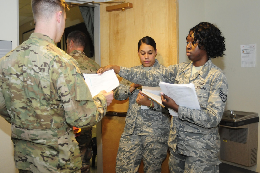 Airman 1st Class Narissa Bennett and Staff Sgt. Amy Akpiri, both members of the 137th Special Operations Force Support Squadron at Will Rogers Air National Guard Base in Oklahoma City, in-process personal back from a recent deployment during their annual training days at the 1st Special Operations Wing, Hurlburt Field, Florida, Aug. 10, 2017. Twenty Airmen from the 137th FSS attended the training event to integrate with active duty personnel on lodging, mortuary, fitness, contingency operations, training and readiness and other duties that are part of their squadron readiness requirements. (U.S. Air National Guard photo by Tech. Sgt. Trisha K. Shields/Released)