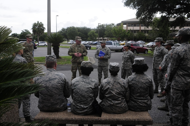 Lt. Col. Christopher Davis, commander of the 137th Special Operations Force Support Squadron at Will Rogers Air National Guard Base in Oklahoma City, gives remarks to members of his squadron during their annual training days at the 1st Special Operations Wing, Hurlburt Field, Florida, Aug. 11, 2017. Twenty Airmen from the 137 SOFSS attended the training event to integrate with active duty personnel on lodging, mortuary, fitness, contingency operations, training, readiness and other duties that are part of their squadron readiness requirements. (U.S. Air National Guard photo by Tech. Sgt. Trisha K. Shields/Released)