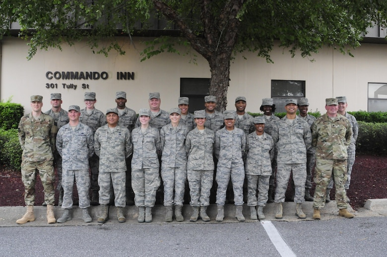 Airmen from the 137th Special Operations Force Support Squadron pose for a group picture during their annual training days at the 1st Special Operations Wing, Hurlburt Field, Florida, Aug. 11, 2017. Twenty Airmen from the 137 SOFSS attended the training event to integrate with active duty personnel on lodging, mortuary, fitness, contingency operations, training, readiness and other duties that are part of their squadron readiness requirements. (U.S. Air National Guard photo by Tech. Sgt. Trisha K. Shields/Released)