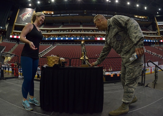 Brig. Gen. Brook Leonard, 56th Fighter Wing commander, rings the bell after completing the 9/11 Tower challenge Sept. 8, 2017 at Gila River Area in Glendale, Ariz. The 9/11 Tower Challenge was held to honor first responders who lost their lives during the Sept. 11, 2001 attacks and to show their support to first responders and military members who continue to protect the U.S. from foreign and domestic threats. (U.S. Air Force photo by Senior Airman Devante Williams)