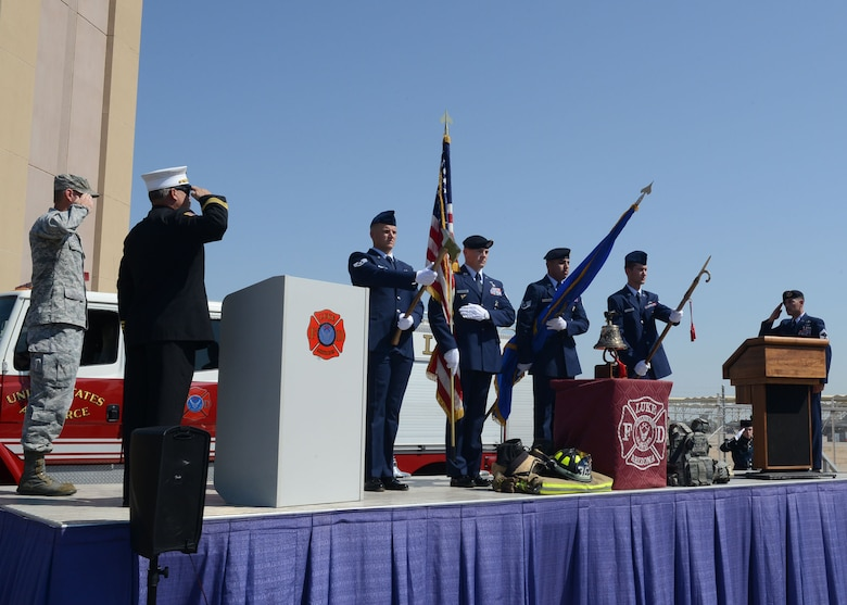 Airmen from the 56th Civil Engineer Squadron perform a color guard sequence during Team Luke's 9/11 remembrance ceremony Sept. 11, 2017 at Luke Air Force Base, Ariz. The ceremony included a flag unfurling, recount of events, a moment of silence and a ten story stair climb honoring those who lost their lives during the terrorist attack. (U.S. Air Force photo/ Senior Airman James Hensley)