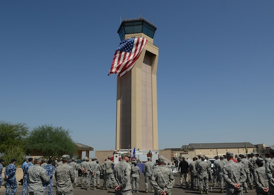 Luke Thunderbolts pay tribute to those killed in the Sept. 11, 2001 terrorist attacks by participating in Team Luke's 9/11 remembrance ceremony Sept. 11, 2017 at Luke Air Force Base, Ariz. The Airmen climbed and descended ten stories of stairs in the air traffic control tower carrying with them ribbons that contained the names of those who lost their lives during the terrorist attack. (U.S. Air Force photo/ Senior Airman James Hensley)