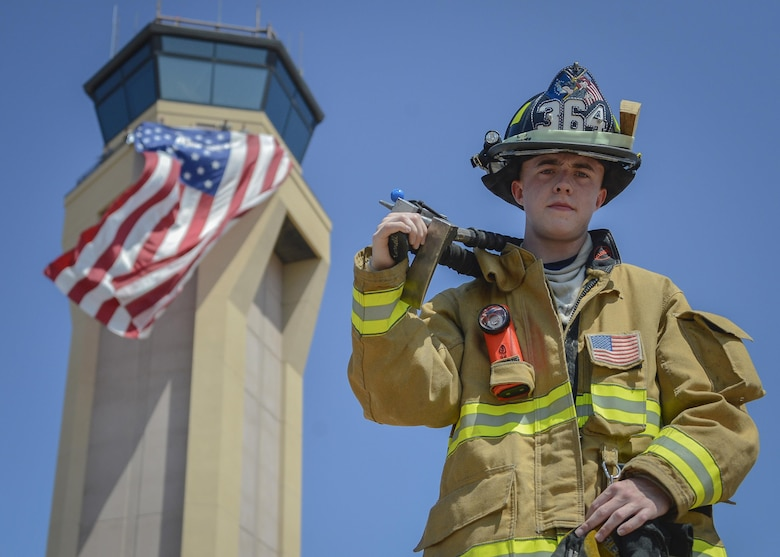 Senior Airman Owen Ricker, 56th Civil Engineer Squadron Fire Fighter, poses for a portrait Sept. 11, 2017 at Luke Air Force Base, Ariz. During Team Luke's 9/11 remembrance ceremony, Ricker played his ceremonial bagpipes and also participated in a ten story stair climb in the air traffic control tower honoring those who lost their lives during the 2001 terrorist attacks. (U.S. Air Force photo/Airman 1st Class Caleb Worpel)