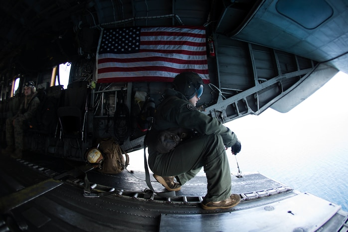 U.S. Marine Corps Sgt. Andrew J. Mocarski with Marine Medium Tiltrotor Squadron (VMM) 162 (Reinforced), 26th Marine Expeditionary Unit (MEU), looks out the back of a CH-53E Super Stallion to deliver essential emergency care items to St. Thomas, U.S. Virgin Islands, Sept. 10, 2017. The 26th MEU is supporting authorities in the U.S. Virgin Islands with the combined goal of protecting the lives and safety of those in affected areas.