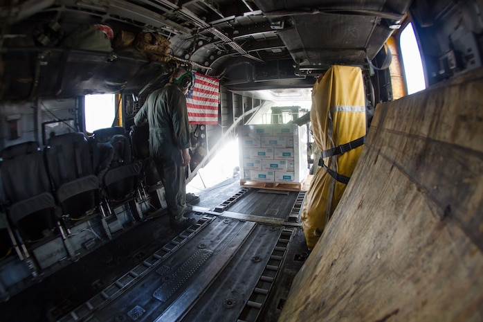 U.S. Marines with the 26th Marine Expeditionary Unit (MEU), and U.S. Air Force Airmen, unload a CH-53E Super Stallion with Marine Medium Tiltrotor Squadron (VMM) 162 (Reinforced), 26th MEU, at the St. Thomas Cyril King E. Airport, U.S. Virgin Islands, Sept. 10, 2017. The 26th MEU is supporting authorities in the U.S. Virgin Islands with the combined goal of protecting the lives and safety of those in affected areas.