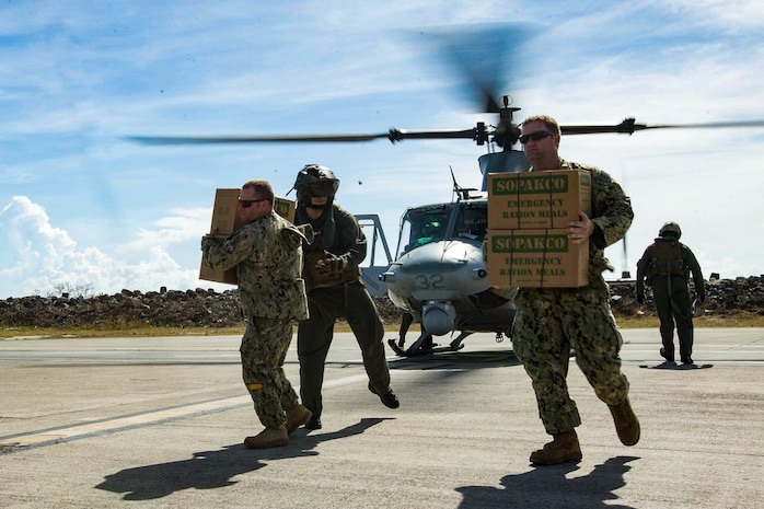 U.S. Marines and Sailors with the 26th Marine Expeditionary Unit (MEU), deliver food and water by way of UH-1Y Venom helicopters to St. Thomas Cyril King E. Airport, U.S. Virgin Islands in effort of aiding victims of Hurricane Irma in the U.S. Virgin Islands, Sept. 10, 2017. The 26th MEU is supporting the lead federal agency in providing humanitarian relief efforts for Hurricane Irma.
