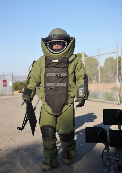 Senior Airman Jared Basham, 9th Civil Engineer Squadron explosive ordnance technician, responds to a scenario in a bomb suit during Urban Shield