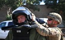 9th Civil Engineer Squadron explosive ordnance technicians, Senior Airman Jared Basham (right) and Staff Sgt. Robert Powell prepare to respond to a scenario during Urban Shield
