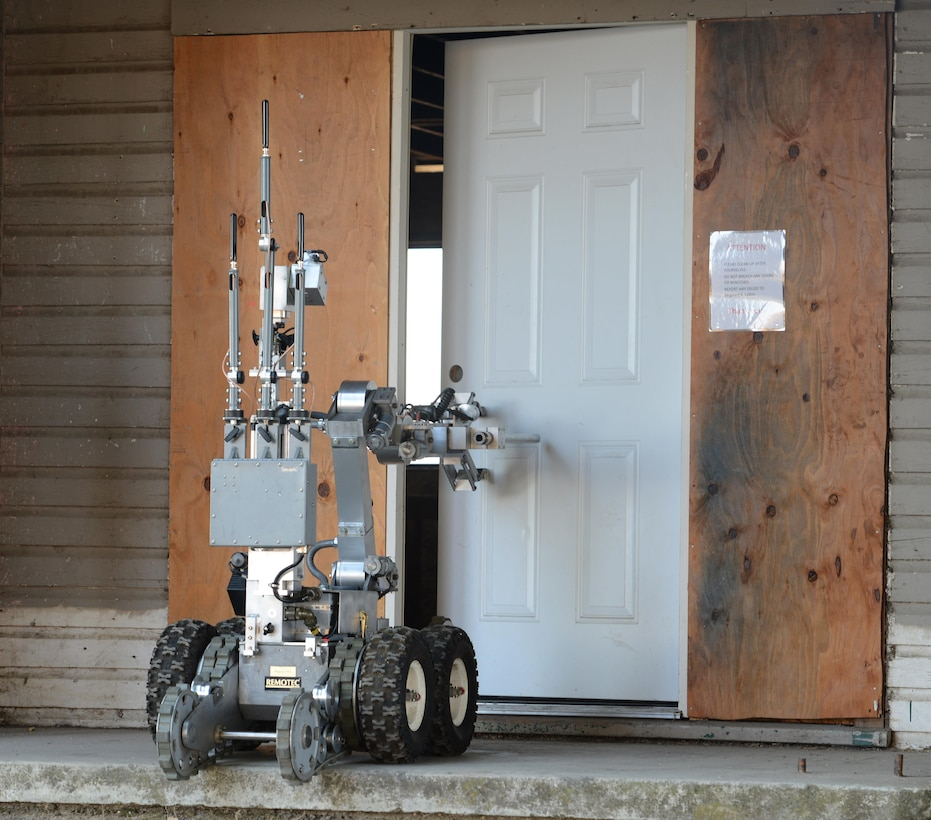A robot controlled by 9th Civil Engineer Squadron explosive ordnance technicians opens a door during Urban Shield